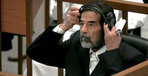Former Iraqi leader Saddam Hussein listens to evidence during the Anfal trial in Baghdad
