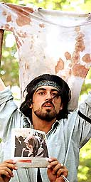Iranian student Ahmed Batebi holds up a bloodied T-shirt during protests at Tehran university on July 12, 1999. He was sentenced to 10 years in prison. Photograph: Jamshid/Reuters