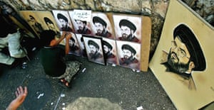 A boy sells posters of the Hizbullah leader, Hassan Nasrallah