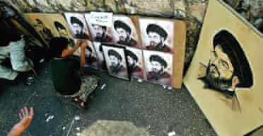 A boy sells posters of the Hizbullah leader, Hassan Nasrallah