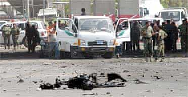 Iraqi security forces gather at the site of a car bomb explosion outside the interior ministry in Baghdad