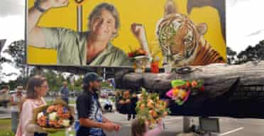Local residents leave flowers in memory of Steve Irwin at the entrance to his Australia Zoo in Queensland