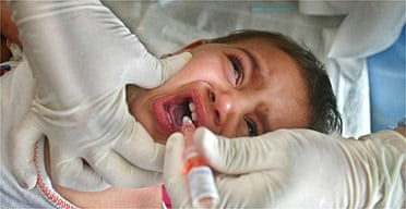 A child is treated at a clinic in a drive to protect Iraqi children from tuberculosis and other diseases
