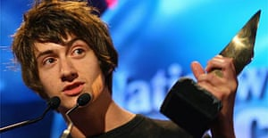 Alex Turner takes the award for the Arctic Monkeys, whose refusal to play the media game has irked some critics. Photograph: Stephen Hird/Reuters
