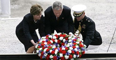George Bush and his wife Laura lay a wreath commemorating the fifth anniversary of the 9/11 attacks at the site of  the World Trade Center. Photograph: Fabiano/EPA