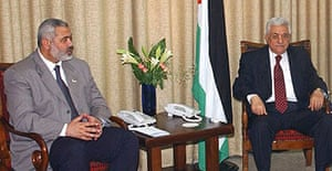Palestinian prime minister Ismail Haniyeh, left, with president Mahmoud Abbas in Gaza City after an agreement was made to form a coalition government.