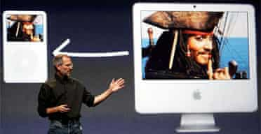 Apple CEO Steve Jobs announces the new video download service from iTunes during an event in San Francisco. Photograph: Justin Sullivan/Getty