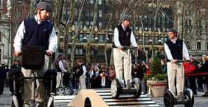 Segway riders demonstrate how to use the electric scooter. Photograph: Louis Lanzano/AP