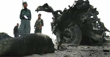 The remains of a suicide attacker lie next to the car he blew up in Kabul