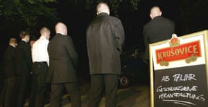 Members of the far-right German National Democratic Party (NPD) guard the access road of a restaurant, where the party celebrates its election wins in the German town of Schwerin.