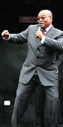 Jacob Zuma celebrates after the corruption charges against him were dropped