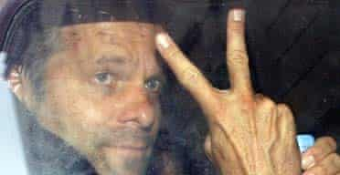 Norbert Teufelberger, Bwin co-founder, gestures as he leaves a court in Nice following his arrest