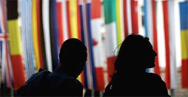 Bulgarians in Sofia walk past flags