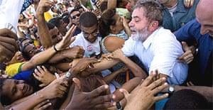 Luiz Inãcio Lula da Silva greets supporters during a rally in Bahia