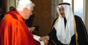 Pope Benedict XVI shakes hands with the Kuwaiti ambassador to the Holy See, Ahamad Abdulkareem Al-Ibrahim