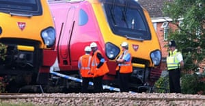 Investigators examine the train that collided with a car in Copmanthorpe