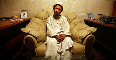 Would-be recruit Abdullah waits in the Ghazni intelligence services offices for his transfer to Kabul. Photograph: Declan Walsh