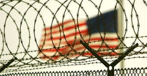 At least nine British residents are held behind the wire at Guantánamo but the US wants to see most of them returned to the UK. Photograph: Brennan Linsley/AP