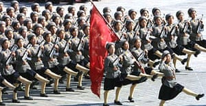 A band of female militia parades in Pyongyang, North Korea