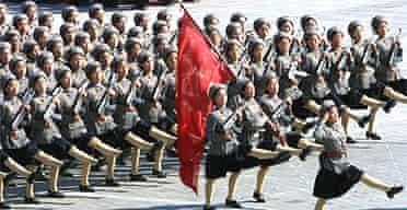 A band of female militia parades in Pyongyang, North Korea