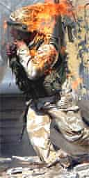 A British soldier is covered in flames from a petrol bomb thrown in Basra, Iraq