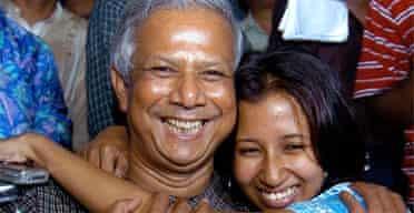 Bangladeshi Nobel peace prize winner Muhammad Yunus is hugged by his daughter Dina
