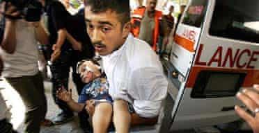 Palestinian girl injured in an Israeli air raid arriving at Shifa hospital