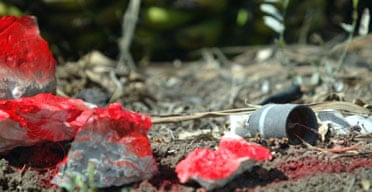 The location of an Israeli cluster bomb is marked with red paint near the village of El Maalliye in southern Lebanon