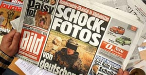 A copy of Bild, which carried the pictures of the German soldiers posing with a human skull