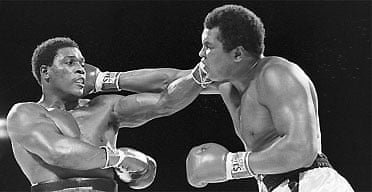 Trevor Berbick, left, and Muhammad Ali seem to have an equal reach as they slug it out during a Friday night boxing match on Dec. 12, 1981 in Nassau, Bahamas