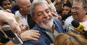 Brazil's president, Luiz Inacio Lula da Silva, greets supporters in front of his apartment in Sao Bernardo do Campo