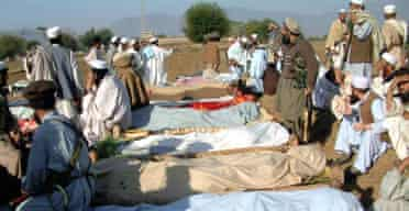 Relatives and local tribesmen gather around the bodies of alleged militants in the Pakistani military's airstrike on a madrasa near the Afghan border