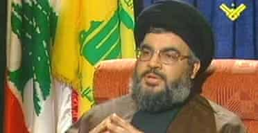 Hizbullah's leader, Sayyed Hassan Nasrallah speaks to a reporter on his group's Manar television channel