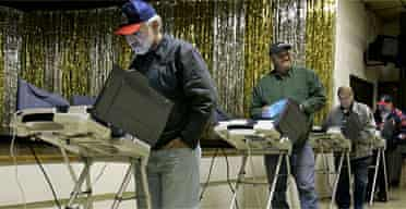 Early morning voters use the electronic voting machines in Newark, Ohio