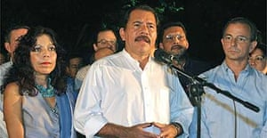 Daniel Ortega addresses supporters after being proclaimed president of Nicaragua next to his wife, Rosario Murillo, and opponent Eduardo Montealegre (r) in Managua