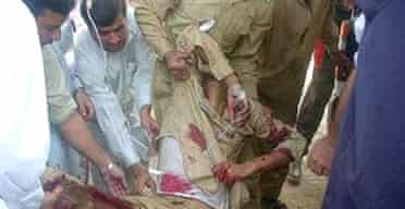 Paramedics tend to an injured Pakistani soldier after a suicide attack which in Dargai