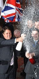 Nick Griffin and Mark Collett celebrate with supporters. Photograph: John Giles/PA