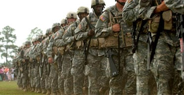A farewell ceremony for US troops deploying to Iraq. Instead of a troop withdrawal next year, Bush is thinking of increasing the numbers