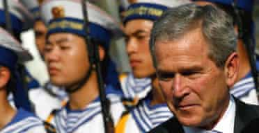The US president, George Bush reviews a guard of honour at the presidential palace in Hanoi at the start of his visit to Vietnam