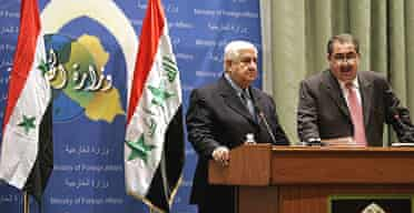 Syria's foreign minister Walid al-Moualem, left, and Iraq's foreign affairs minister, Hoshiyar Zebari, announce the restoration of diplomatic relations between Syria and Iraq, severed 24 years ago.