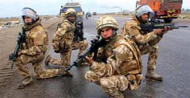 British soldiers patrol a street in the southern city of Basra. Photograph: Essam al-Sudani/AFP/Getty