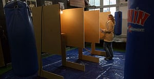 A woman walks over to a polling booth in a boxing school in Amsterdam, to vote in the Dutch parliamentary elections.