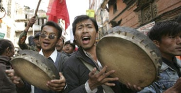People in Kathmandu celebrate the peace agreement between the Nepalese government and the country's Maoists rebels
