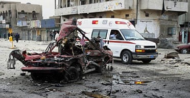 An Ambulance rushes to the scene of a car bomb in the Sadr City district of Baghdad