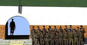 Iranian soldiers stand guard at the Azadi stadium in Tehran during a qualifying round for the 2006 World Cup