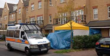 Police outside Mr Litvinenko's home, where radioactive material has been found