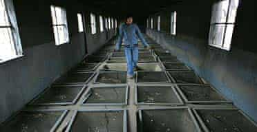 A Chinese woman visits the ruins of the yellow-rat breeding room at the Japanese germ warfare centre operated by Unit 731, near the Chinese city of Harbin