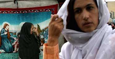 Women at a street market in Kabul. Photograph: Rodrigo Abd/AP
