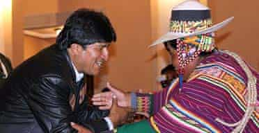 The Bolivian president, Evo Morales, shakes hands with Martin Condori, one of the peasants' leaders, after signing the land reform bill