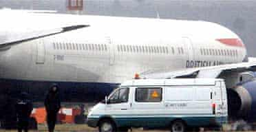 A van belonging to Russian radiation safety experts is parked near a grounded BA jet at Domodedovo airport, Moscow. Photograph: Mikhail Metzel/AP